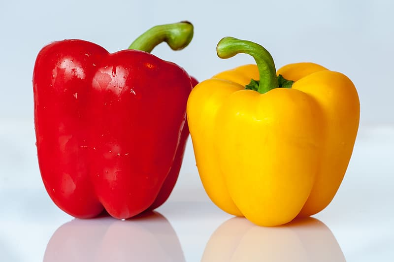 two red and yellow bell peppers
